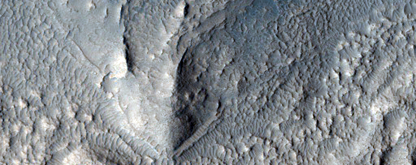 Crater with Gullies, Debris Mantle, Layers Exposed in Eastern Wall