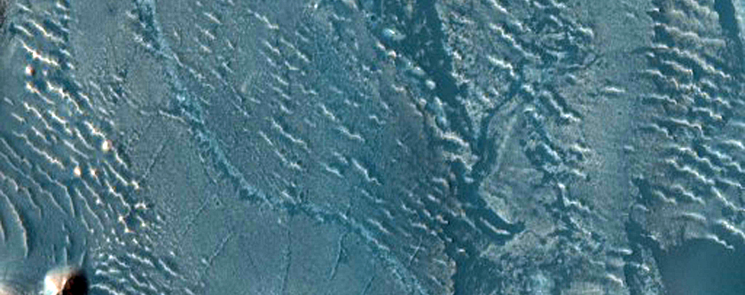 Crater in Western Arabia Terra with Stair-Stepped Hills and Dark Dunes