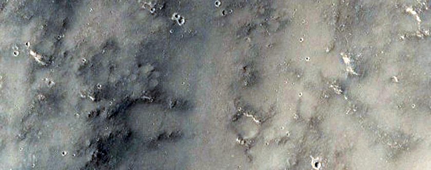 Crater/Valley Contact in Licus Vallis