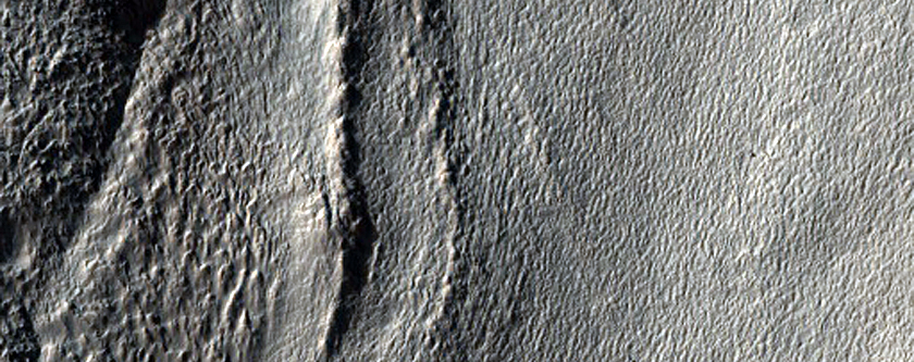 Tongue-Shaped Flow Feature in Hellas Planitia