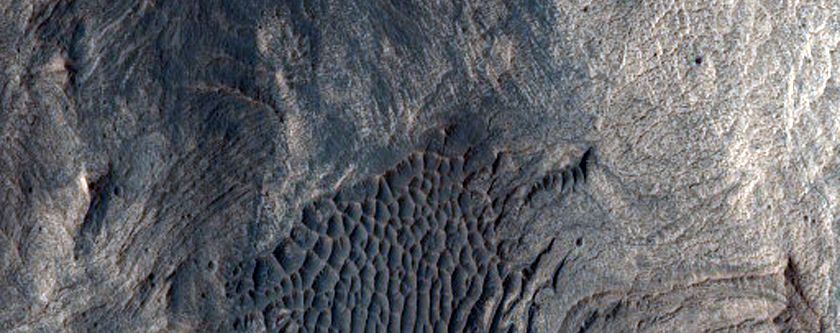 Crater in Layered Deposits of West Candor Region