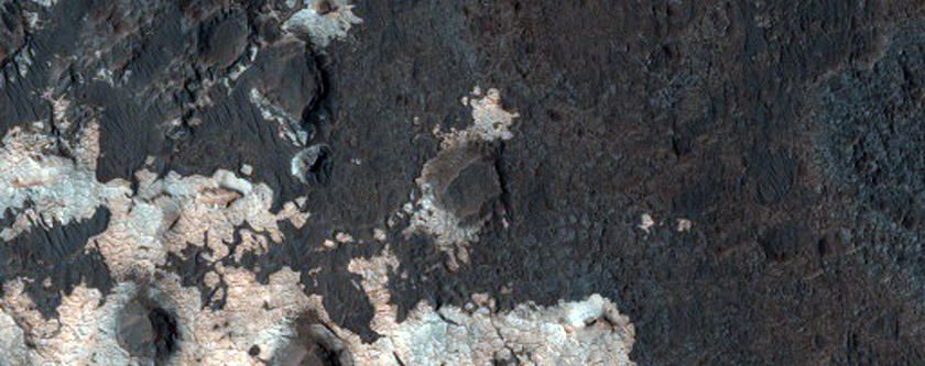 Light-Toned Rock Outcrops in/Near MOC Image R09-00101 North of Sigli Crater
