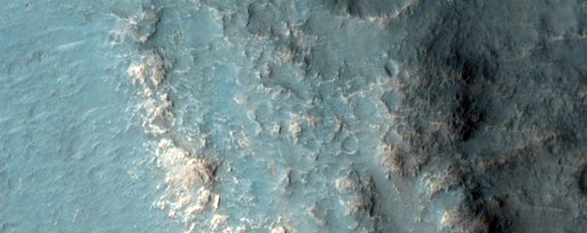 Tyrhenna Terra Crater Rim with Possible Hydrated Minerals