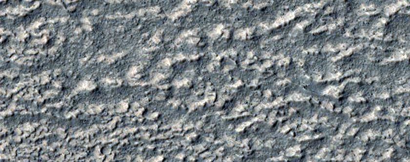 Lobate Deposit and Mesa Near Reull Vallis