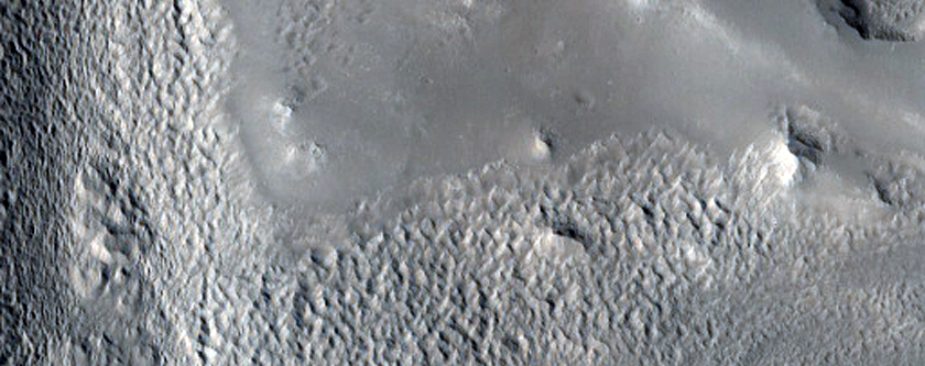 Valleys on the Ejecta Blanket from Cerulli Crater