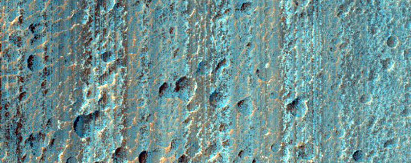 Gullies with Dark Channels on South-Facing Crater Slope