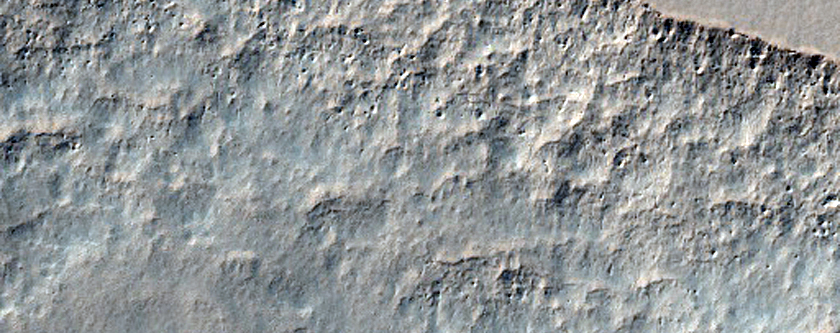 Scalloped Terrain within a Crater at Peneus Patera