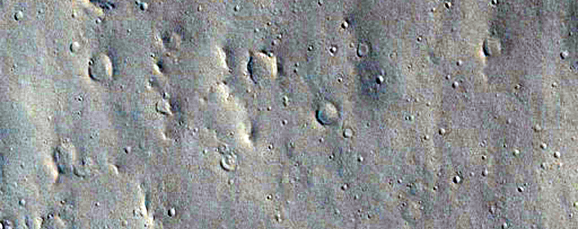 Catastrophic Outflow Features in Tharsis Region