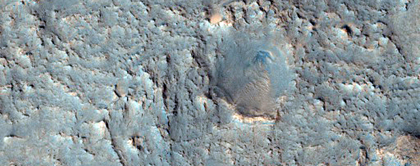Linear Intersecting Ridges in Floor of Crater Seen in MOC Image R19-00335