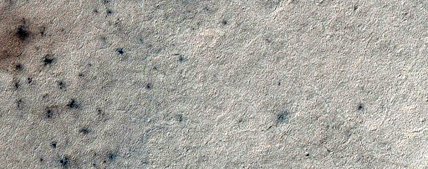 Splotches and Channels Near Sisyphi Montes