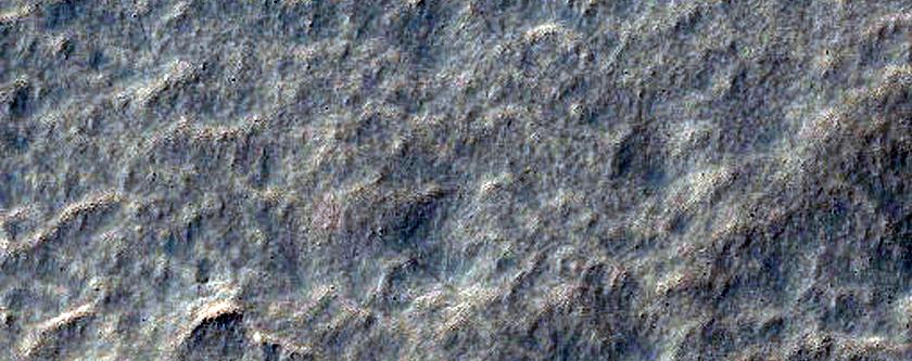 Scalloped Terrain in Mid-Latitude Mantle at Peneus Patera
