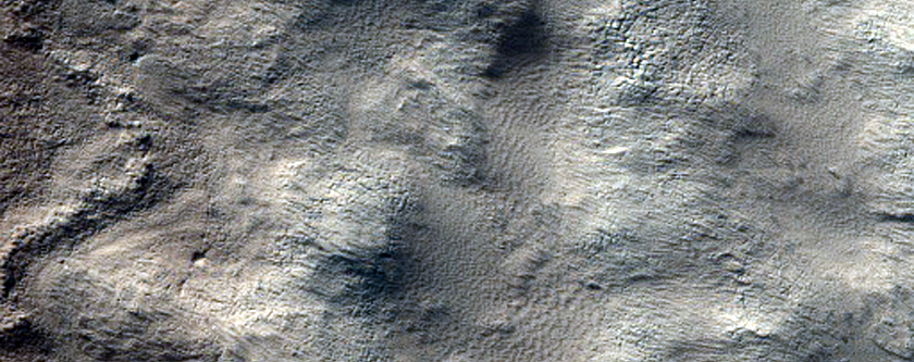Exposure of Polar Layered Deposits in Area Poorly Observed