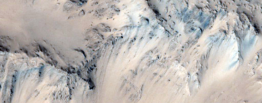 Well-Preserved Unnamed Crater Near Tartarus Region