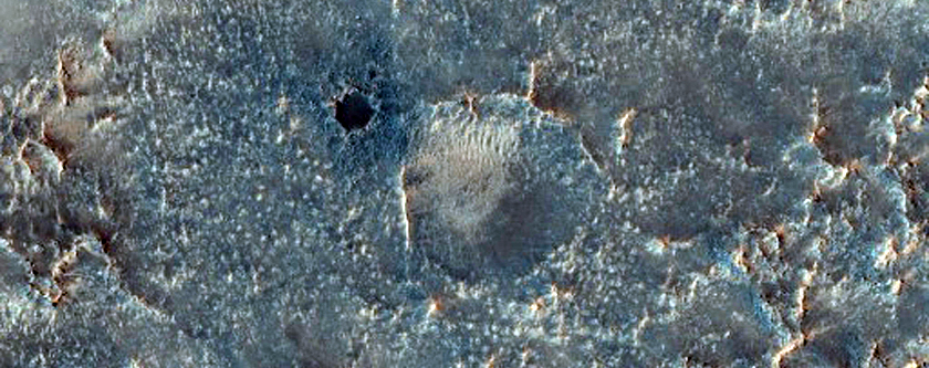 Possible Quartz Monzonite Outcrop in Antoniadi Crater
