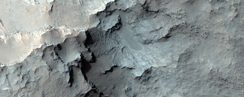 Pit of Crater Floor Exposing Layered Deposits