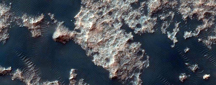 Putative Eroded Impact Melts of the Floor of Ritchey Crater