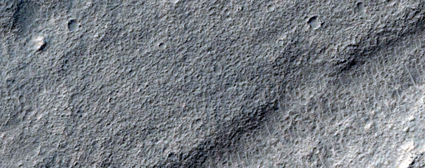 Reull Vallis and Valley Cut through Crater
