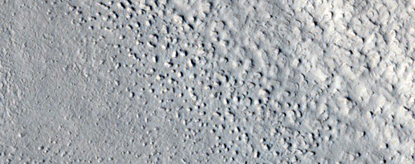 Fretted Terrain and Mass-Movement Feature in Coloe Fossae