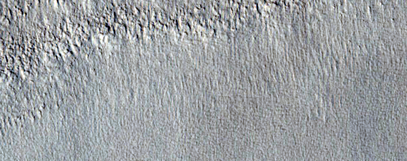 Gullies on Mesa Slope Seen in and Near MOC Image E14-00696