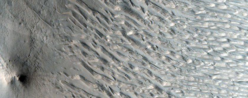 Mysterious Bright and Dark Slope Streaks in Arabia Terra