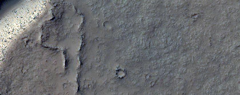 Wrinkle Ridge Cut by Theater-Headed Channels in Memnonia Fossae