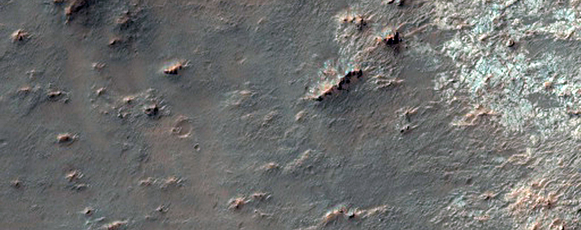 Crater Intersected by Valleys East of Huygens Crater