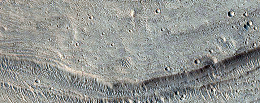 Lobate Fan Deposit at Mouth of Channel in Crater East of Maja Valles