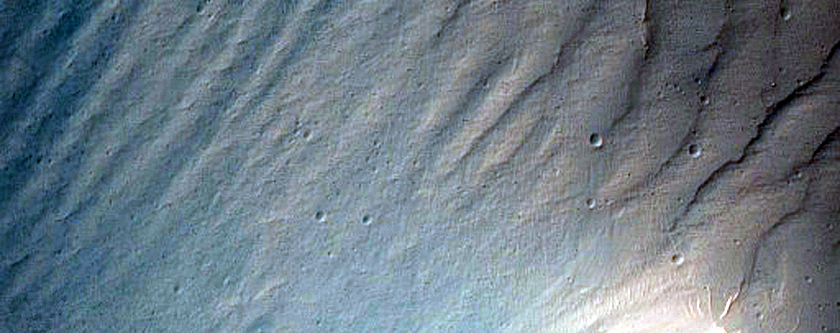 Finely-Gullied Debris on Slope Seen in MOC Images E10-02013 and S02-01076