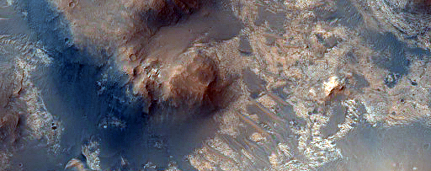 Light-Toned Outcrops Exhumed From Dark Material in Arabia Terra