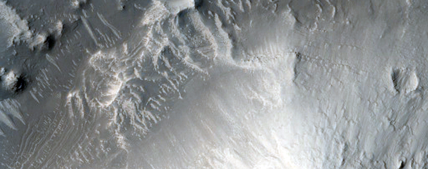 Possible Layered Deposits within Unnamed Crater in Arabia Terra