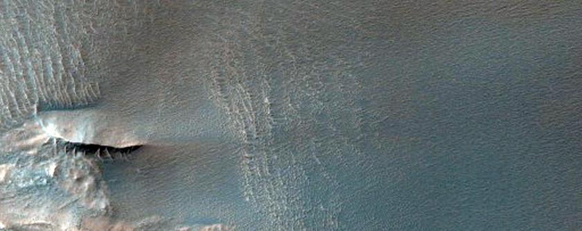 Wind Streaks and Unusual Dark Dunes in Ius Chasma