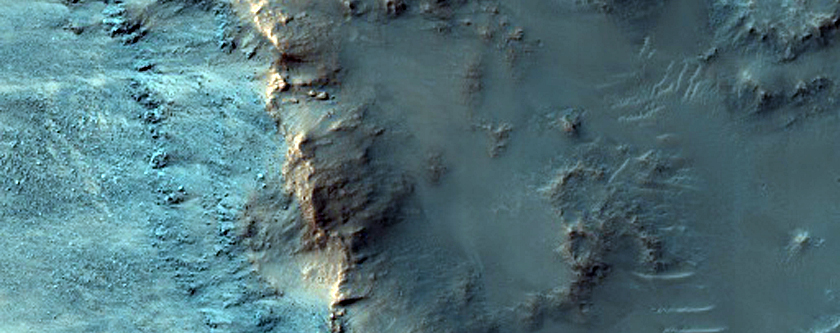 Olivine-Rich Bedrock Exposed in Unnamed Crater Wall in Tyrrhena Terra