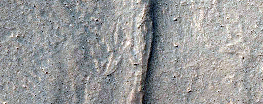 Concentric Ridges Near Alcoves Northwest of Oudemans Crater