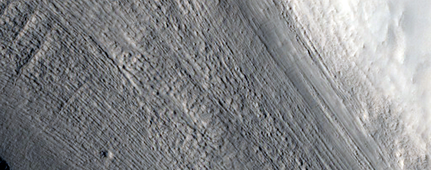 Tributary Glacier-Like Feature with Parallel Lineations on Valley Wall