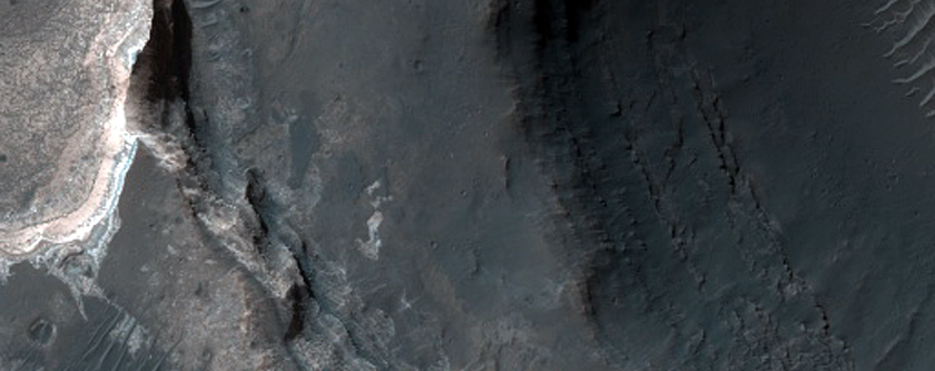 Light-Toned Layered Deposit on Floor of Small Trough in Coprates Catena