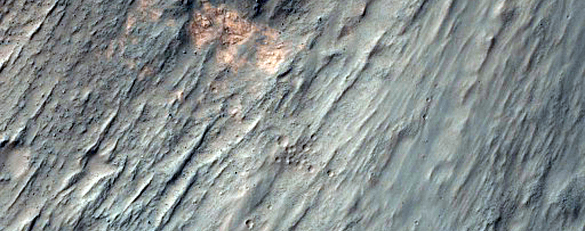 Coprates Chasma Layers and Flow Forms Seen in MOC Image R23-01363