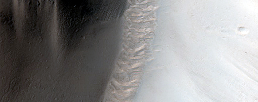 Channels in Breached Crater