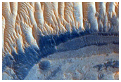 Light-Toned Layered Sediments Exposed within Pit at Noctis Labyrinthus