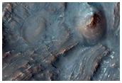 Uplift of Layered Materials From the Intersection of Two Craters