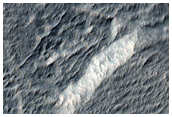 Depressions within Mantle in Promethei Terra