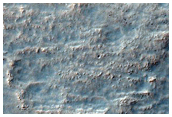 Possible Olivine-Rich Degraded Channel Wall Near Clark Crater