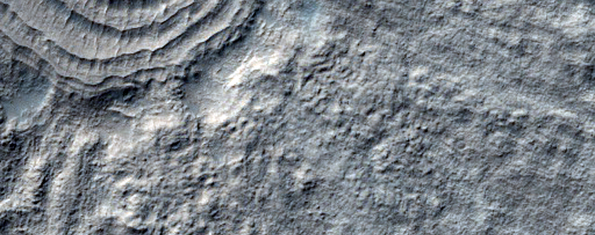 Crater with Pedestalized Ejecta and Concentric Circles on Floor