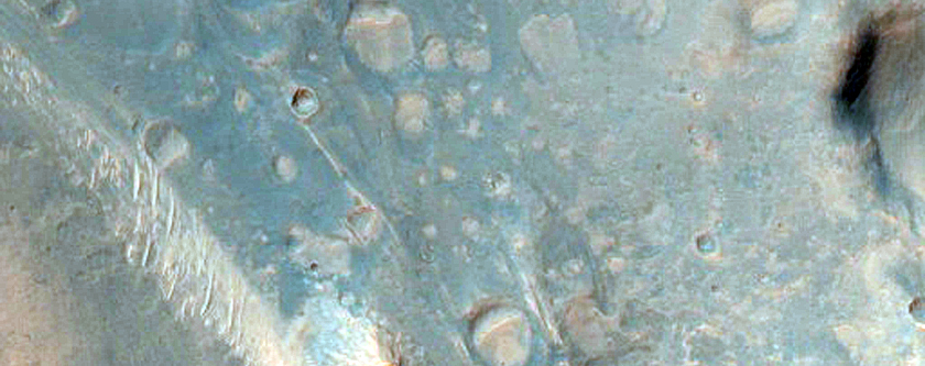 Dark Central Uplift in an Unnamed Crater in Hesperia Planum