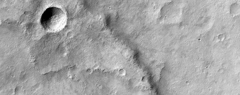 Very Fresh Impact Crater Superposing a Wrinkle Ridge in Hesperia Planum