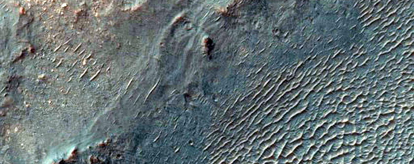 Light-Toned Layers Exposed by Crater in Plains North of Valles Marineris
