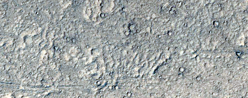 Crater and Fans Embayed by Flow Material in Kasei Valles