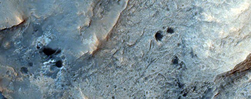 Vertically Tilted Blocks of Layers in Becquerel Crater