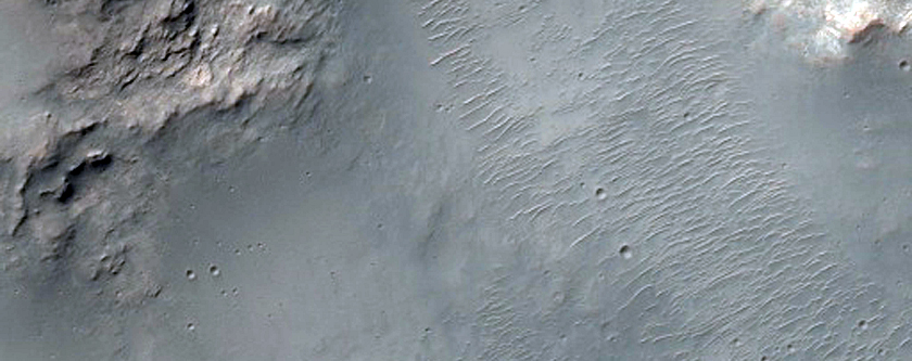 Bedrock Exposed by 8-Kilometer Crater in Hesperia Planum