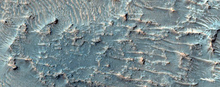 Possible Olivine Signature on Plains near Crater with Fluidized Ejecta