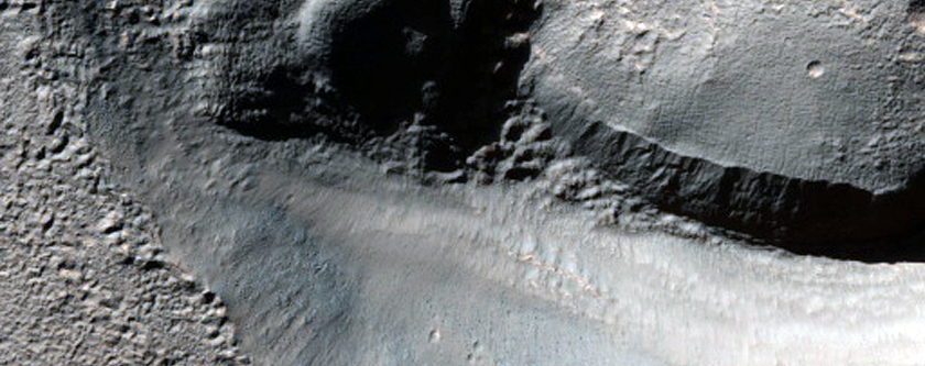 Crater Deposit with Layers Near Hellas Basin